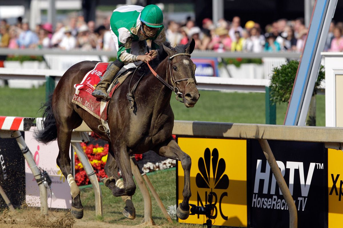 BALTIMORE, MD - MAY 20: Jockey Jose Lezcano aboard Royal Delta crosses the finish line to win the Black-Eyed Susan Stakes at Pimlico Race Course on May 20, 2011 in Baltimore, Maryland.  (Photo by Rob Carr/Getty Images)