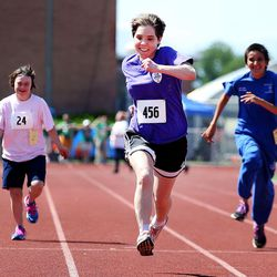 Kira Uchida, of the Weber State Wildcats, center, competes in the 50-meter race at the Special Olympics Utah's 48th annual Summer Games at Provo High School on Friday, June 2, 2017. Uchida came in first place in her heat. Nearly 1,300 athletes will compete during the two-day event with support from nearly 500 coaches and hundreds of volunteers.