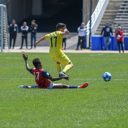 Valdo Etienne (47) slide tackle during the opening match of the 40th Annual Dallas Cup.
