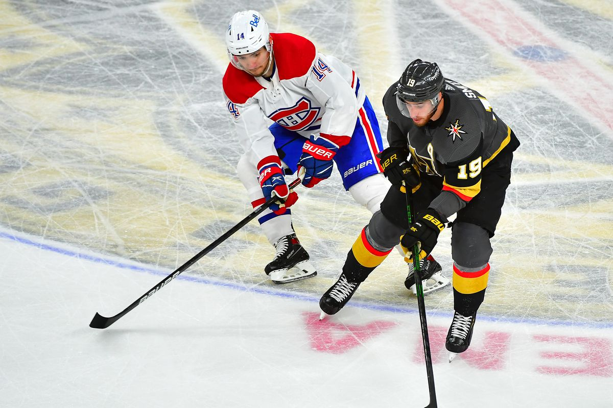 Montreal Canadiens center Nick Suzuki (14) looks to defend against a pass from Vegas Golden Knights right wing Reilly Smith (19) during the second period of game one of the 2021 Stanley Cup Semifinals at T-Mobile Arena.