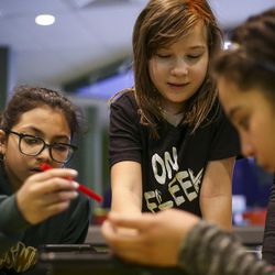 Paloma Velazquez, left, Emma Hopper, middle, and Abigail Juaruz, right, build robots out of Lego blocks during a Lego Camp at Zaniac Learning in Salt Lake City on Monday, Feb. 20, 2017.