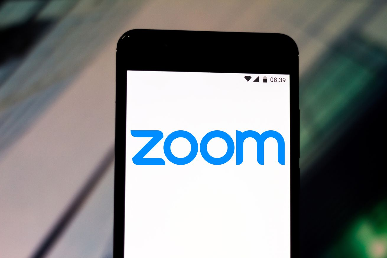 In this photo illustration a Zoom Video Communications logo...