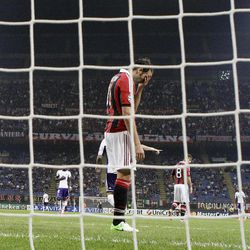 AC Milan forward Giampaolo Pazzini reacts after missing a scoring chance during a Champions League, Group C, soccer match between AC Milan and Anderlecht at the San Siro stadium in Milan, Italy, Tuesday, Sept. 18, 2012.
