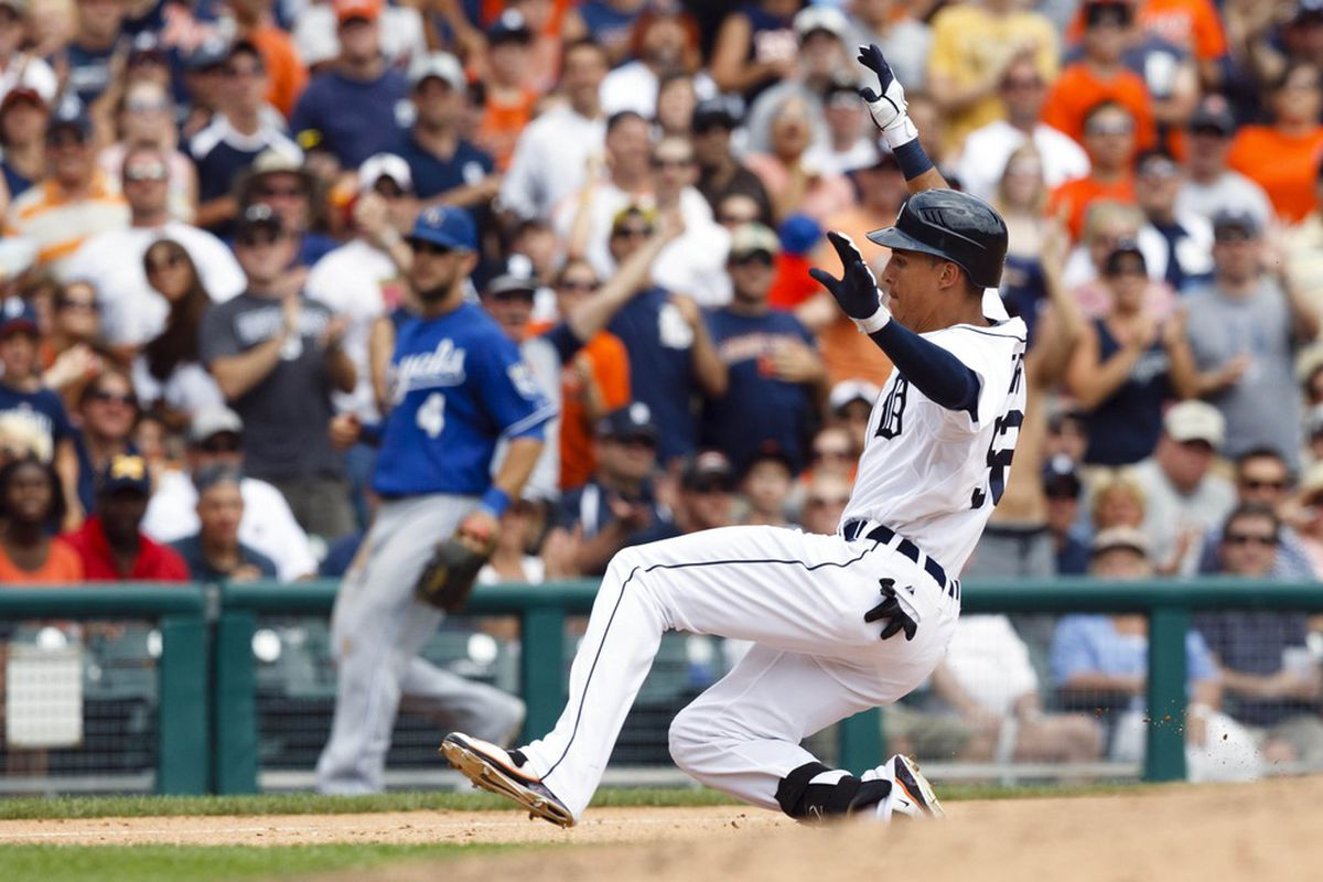 July 8, 2012; Detroit, MI, USA; Detroit Tigers center fielder Quintin Berry (52) slides in safely at third after hitting a triple during the seventh inning against the Kansas City Royals at Comerica Park. Mandatory Credit: Rick Osentoski-US PRESSWIRE