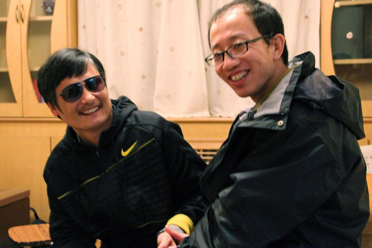 In this photo taken in late April, 2012, and provided by Hu Jia, blind Chinese legal activist Chen Guangcheng, left, meets with Hu at an undisclosed location. Chen, an inspirational figure in China's rights movement, slipped away from his well-guarded rur