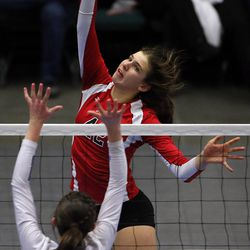 Grace Wiczek of Park City spikes the ball with Mikaela Sorensen of Sky View defending during the girls 4A high school volleyball state championship game in Orem on Thursday, Oct. 26, 2017.