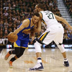 Golden State Warriors guard Stephen Curry #30 attempts to drive past Utah Jazz center Rudy Gobert #27 during game four of the Western Conference Semifinal at Vivant Smart Home Arena in Salt Lake City on Monday, May 8, 2017.