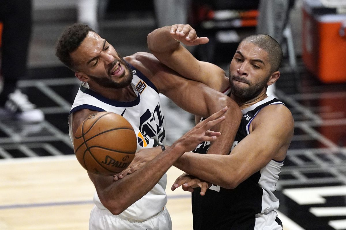 Utah Jazz center Rudy Gobert, left, blocks a pass intended for Los Angeles Clippers forward Nicolas Batum.