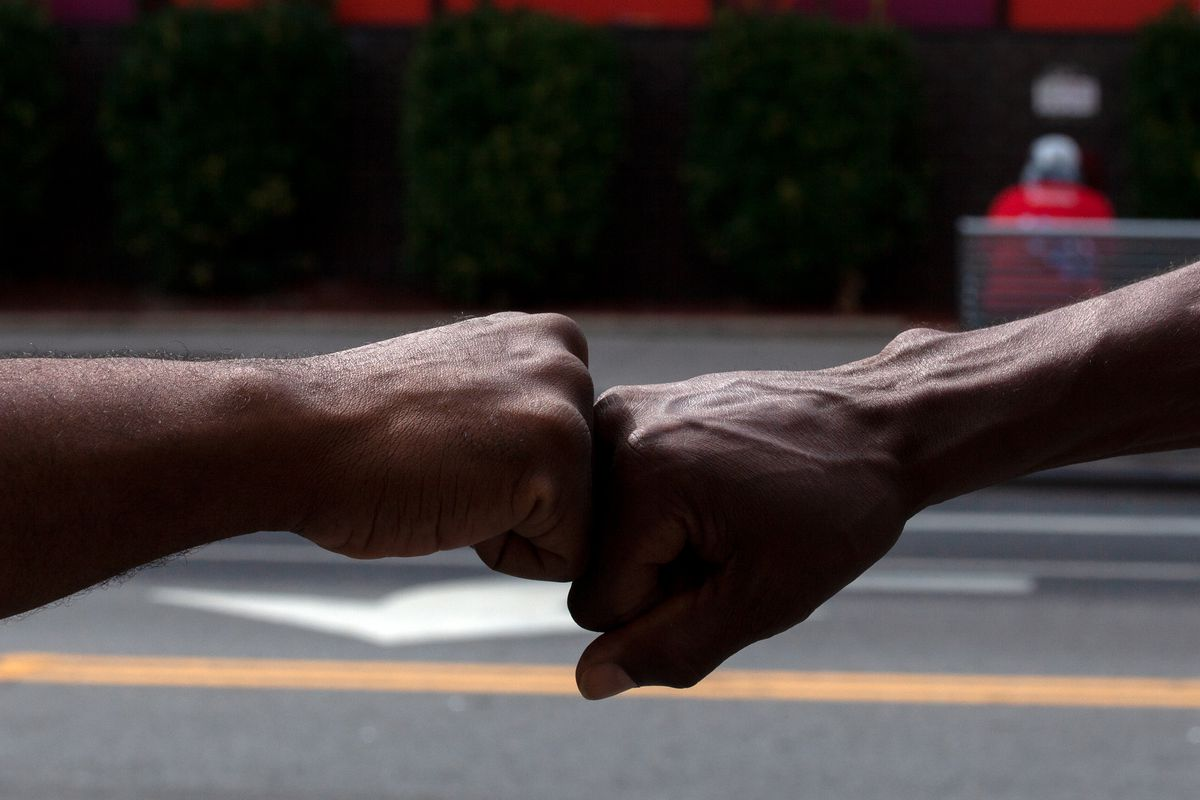 Paul Scurry, 58, right, and Brian Saunderson, 53, connect with each other on Fulton Street in Bed-Stuy, Brooklyn, Sept. 9, 2020.