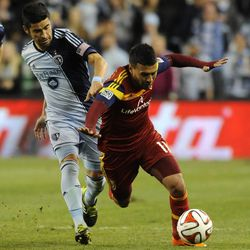 Real Salt Lake's Javier Morales is tripped up by Sporting KC's Paulo Nagamura during a game at Sporting Park in Kansas City, Kan., on Saturday, April 5, 2014.