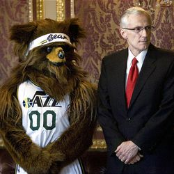 The Jazz Bear and Utah Lt. Governor Greg Bell watch as the governor signs  proclamations honoring retired Utah Jazz coaches Jerry Sloan and Phil Johnson at the Capitol on Monday, March 7, 2011.      Photo/Laura Seitz)