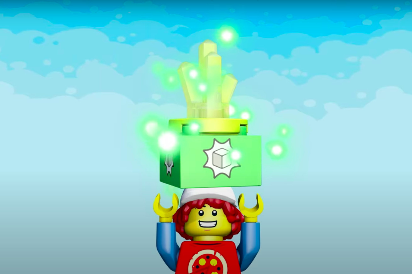 A Lego pizza boy minifig with a Lego trophy hovering above it.
