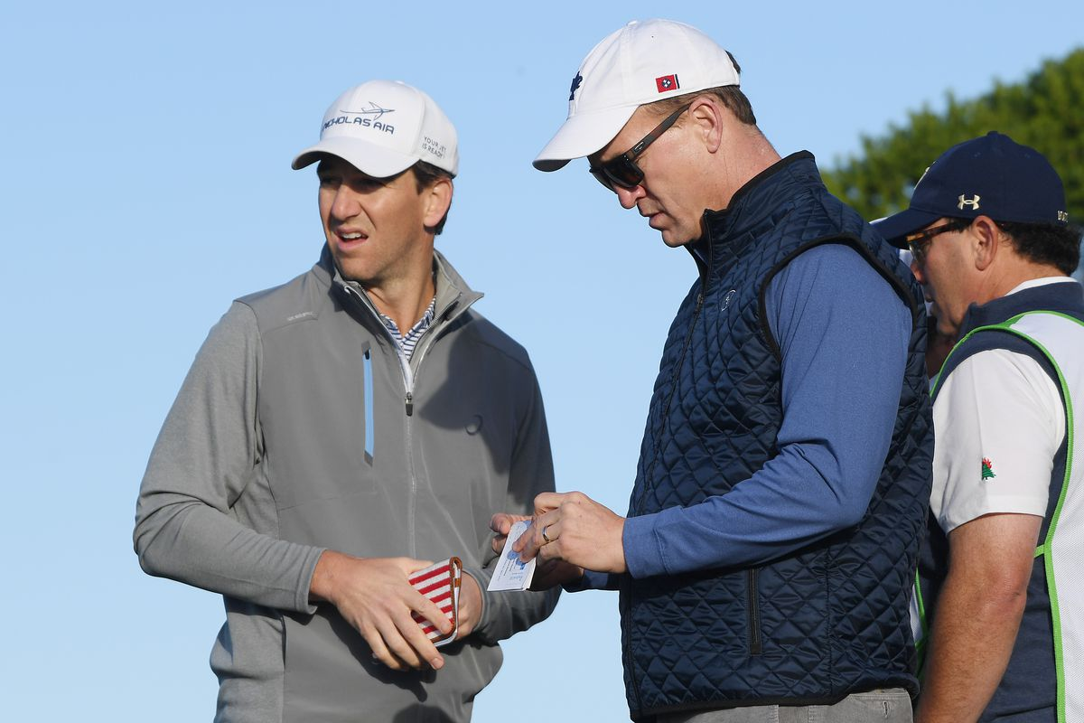Former NFL players Peyton Manning and Eli Manning look on from the 11th tee during the second round of the AT&T Pebble Beach Pro-Am at Monterey Peninsula Country Club on February 07, 2020 in Pebble Beach, California.