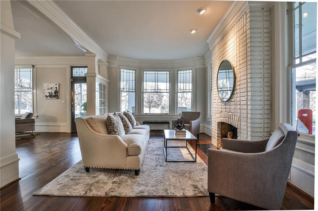 A large living room with a fireplace.