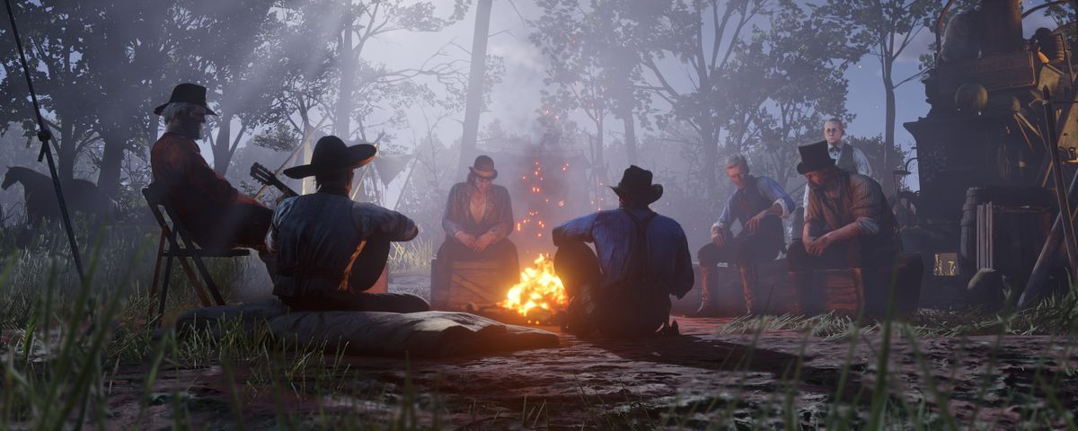 Red Dead Redemption 2 - the Van der Linde Gang gathered around a campfire at night