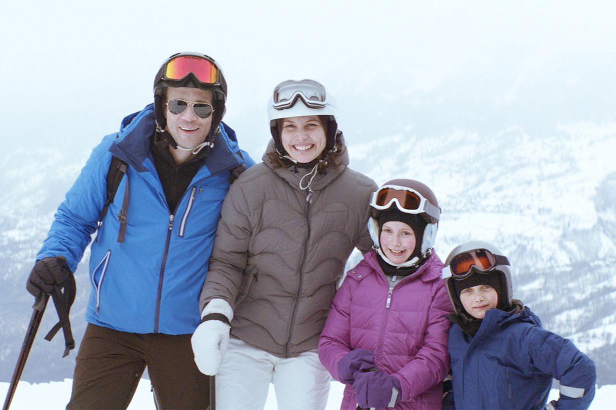 a family posing on the slopes in Force Majeure