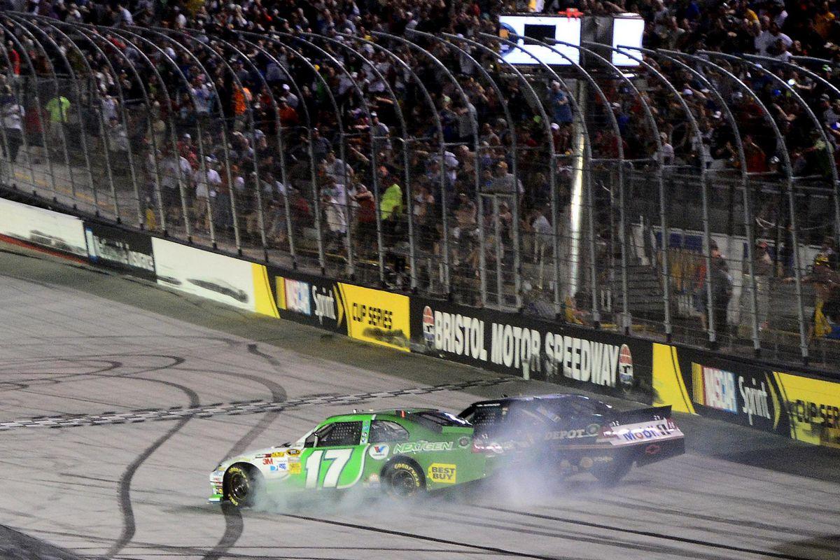 Aug 25, 2012; Bristol, TN, USA; NASCAR Sprint Cup Series driver Matt Kenseth (17) crashes into Tony Stewart (14) during the IRWIN Tools Night Race a Bristol Motor Speedway. Mandatory Credit: Andrew Weber-US Presswire