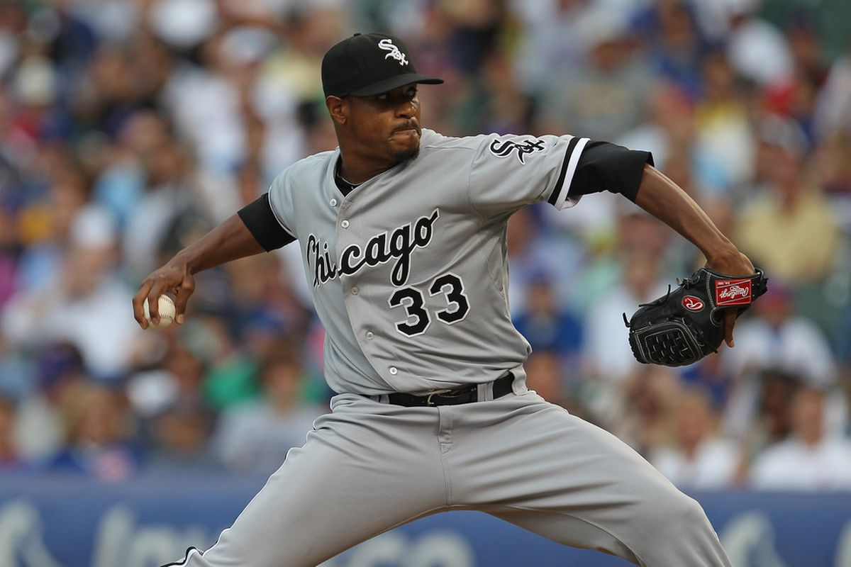 CHICAGO, IL - JULY 01:  Starting pitcher Edwin Jackson #33 of the Chicago White Sox delivers the ball against the Chicago Cubs at Wrigley Field on July 1, 2011 in Chicago, Illinois.  (Photo by Jonathan Daniel/Getty Images)