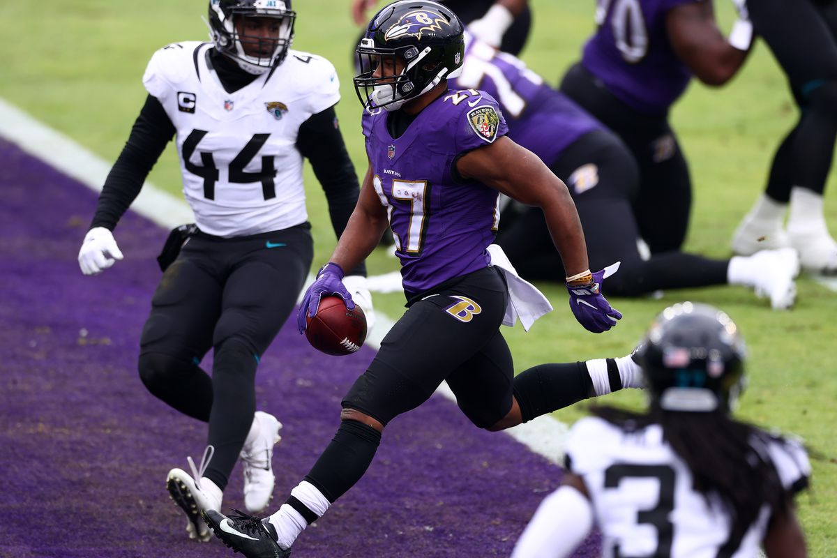 Running back J.K. Dobbins #27 of the Baltimore Ravens carries the ball in for a touchdown during the second quarter of their game against the Jacksonville Jaguars at M&T Bank Stadium on December 20, 2020 in Baltimore, Maryland.