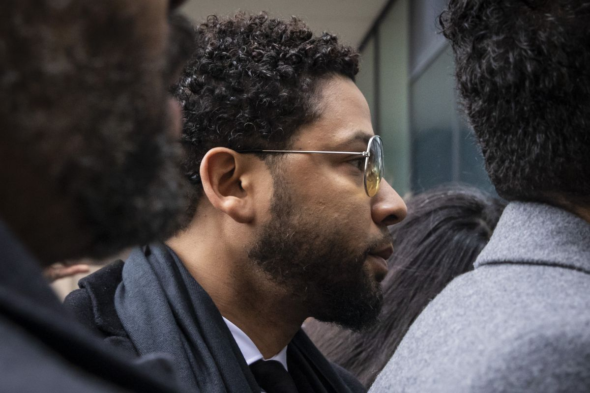 """Former """"Empire"""" actor Jussie Smollett walks into the Leighton Criminal Courthouse for a hearing, Monday morning, Feb. 24, 2020. A new indictment brought by Special Prosecutor Dan Webb charges Smollett with falsely reporting he was the victim of a racist, homophobic attack near his Streeterville apartment in January 2019."""