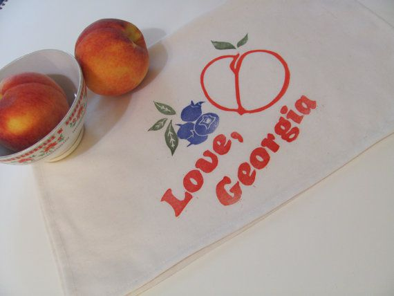 """Kitchen linen for """"Love, Georgia"""" and fruit printed on it."""