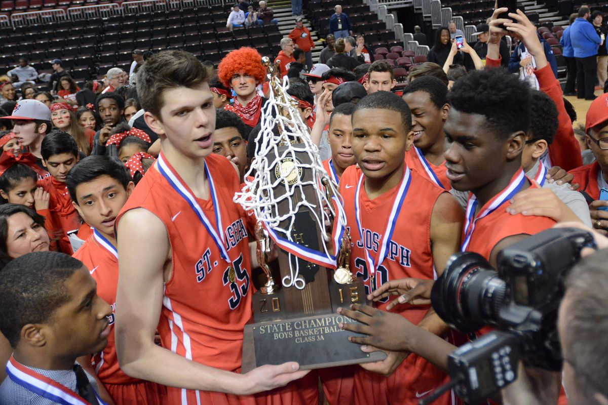 St. Joseph players pose with the Class 3A state championship trophy in 2015.