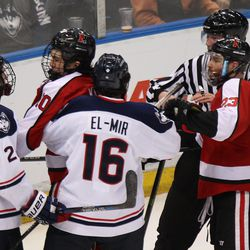 UConn's Joey Ferriss (28) and Karl El-Mir (16) get into a skirmish with two Northeastern players.