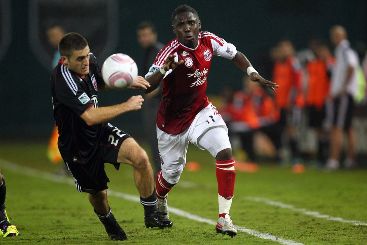 WASHINGTON, DC - OCTOBER 19: Kalif Alhassan #11 of the Portland Timbers controls the ball against Chris Korb #22 of D.C. United at RFK Stadium on October 19, 2011 in Washington, DC.(Photo by Ned Dishman/Getty Images)