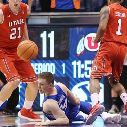 Brigham Young Cougars guard McKay Cannon (24 ) battles for the ball in Provo on Saturday, Dec. 16, 2017. BYU won 77-65.