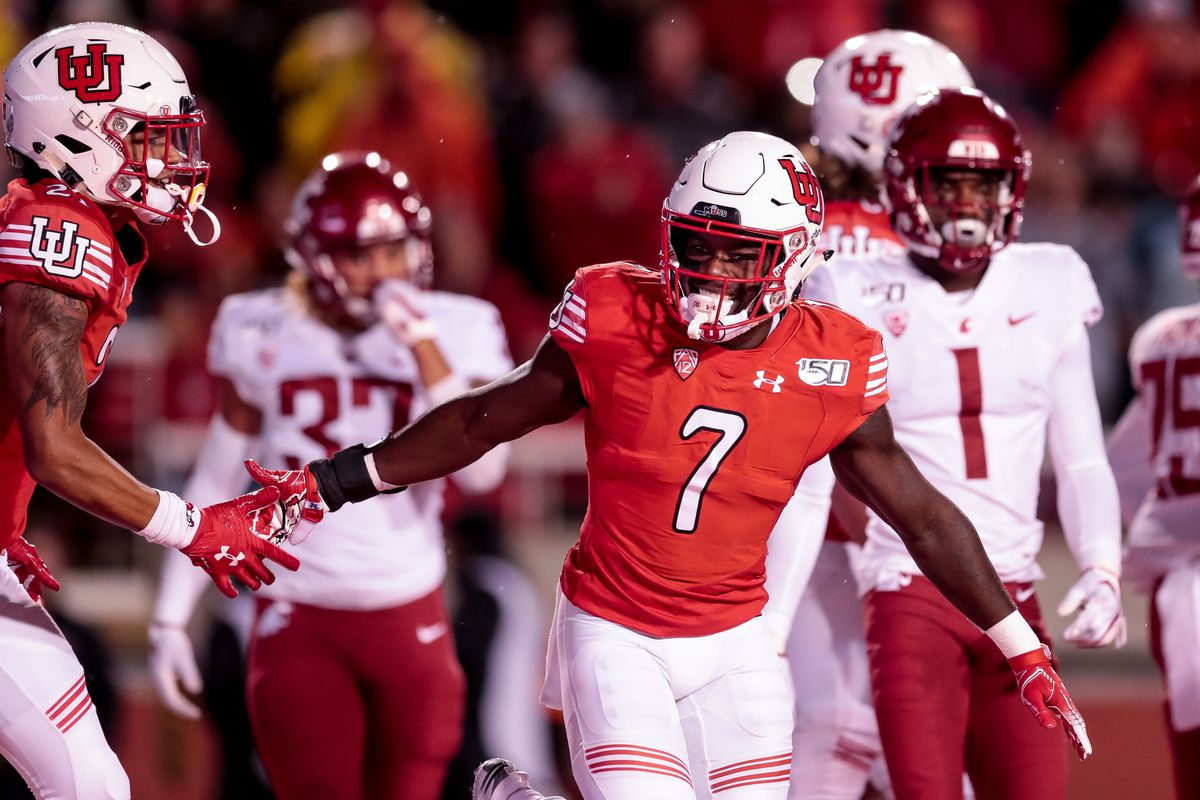 Utah Utes running back Devonta'e Henry-Cole (7) celebrates after scoring a touchdown on a pass from quarterback Tyler Huntley (1), putting the Utes up 7-0 over the Washington State Cougars after the PAT, at Rice-Eccles Stadium in Salt Lake City on Saturday, Sept. 28, 2019.