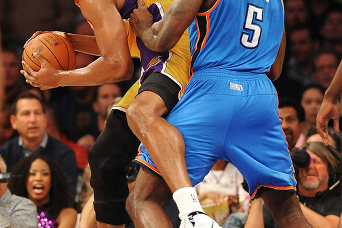 March 29, 2012; Los Angeles, CA, USA; Oklahoma City Thunder center Kendrick Perkins (5) guards Los Angeles Lakers center Andrew Bynum (17) in the first quarter at the Staples Center. Mandatory Credit: Jayne Kamin-Oncea-US PRESSWIRE