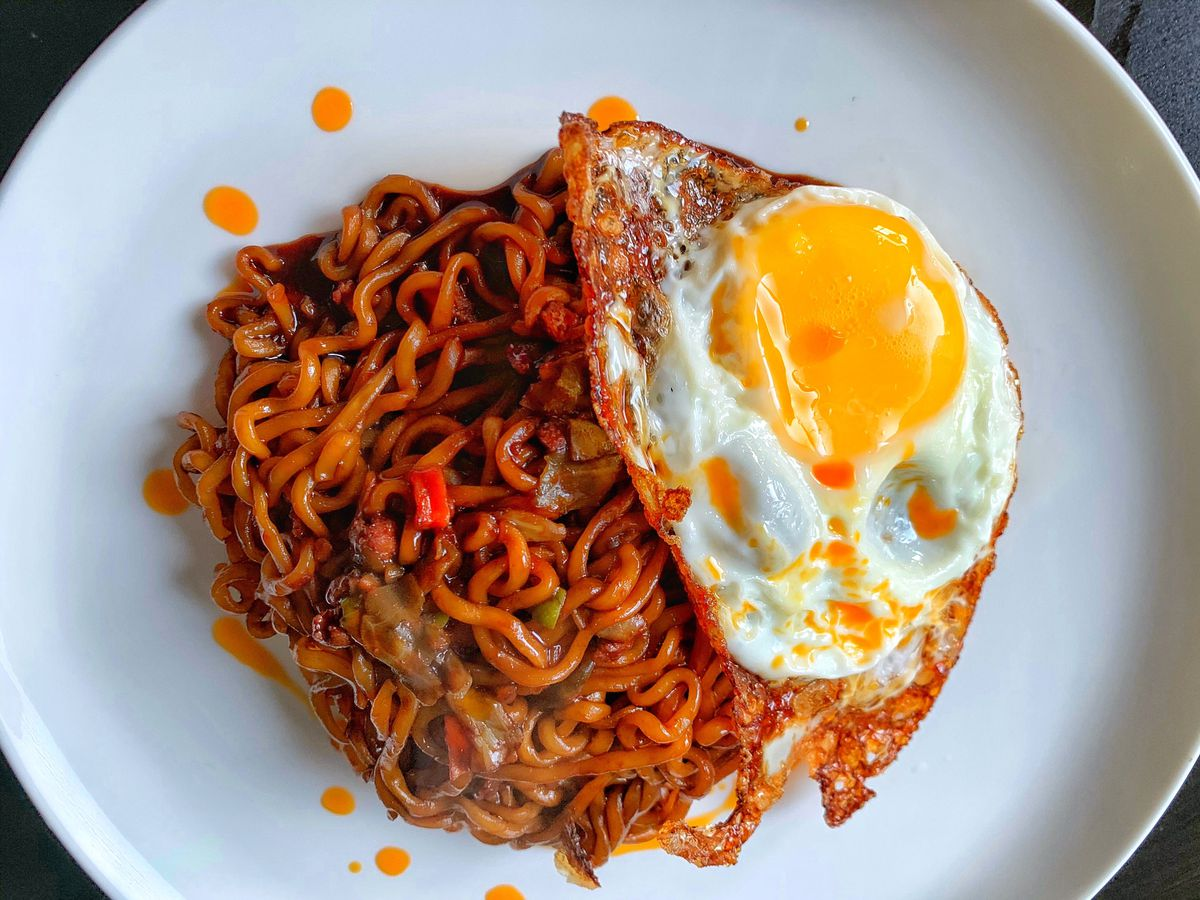 Black bean noodles with fried egg.