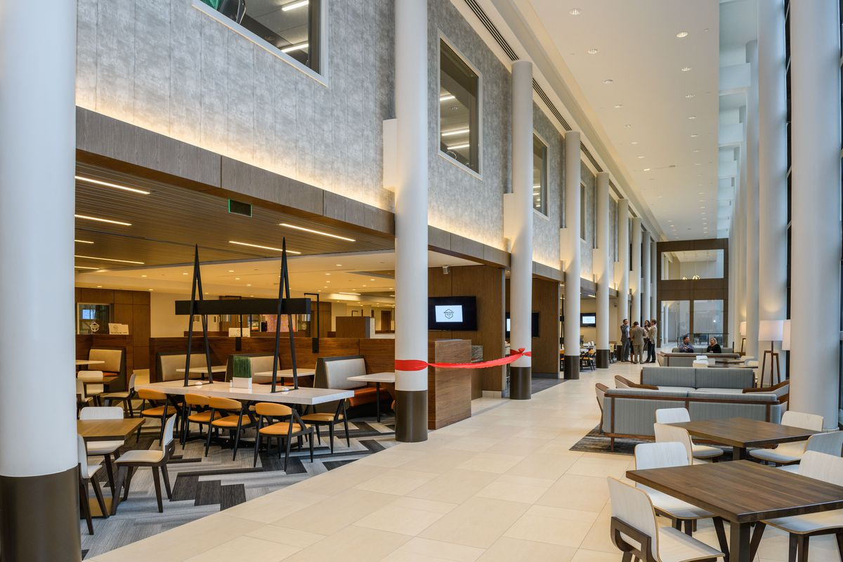 The new food hall features communal seating space in a two-story atrium.
