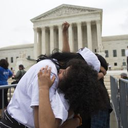 Jackelin Alfaro, 7, of Washington, hugs her aunt Gelin Alfaro, of Veracruz, Mexico, during an immigration rally at the Supreme Court in Washington, Thursday, June 23, 2016. Utah Latino community activist Tony Yapias said Thursday's U.S. Supreme Court ruling halting Obama programs intended to protect millions of unauthorized immigrants from deportation is hurtful and disappointing,