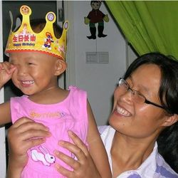 This undated photo provided by the China Aid Association shows Yuan Weijing holding her daughter, Kesi. Yuan's husband, blind Chinese legal activist Chen Guangchen, who angered authorities in rural China by exposing forced abortions, made a surprise escape from house arrest on April 22, 2012, into what activists say is the protection of U.S. diplomats in Beijing, posing a delicate diplomatic crisis for both governments.