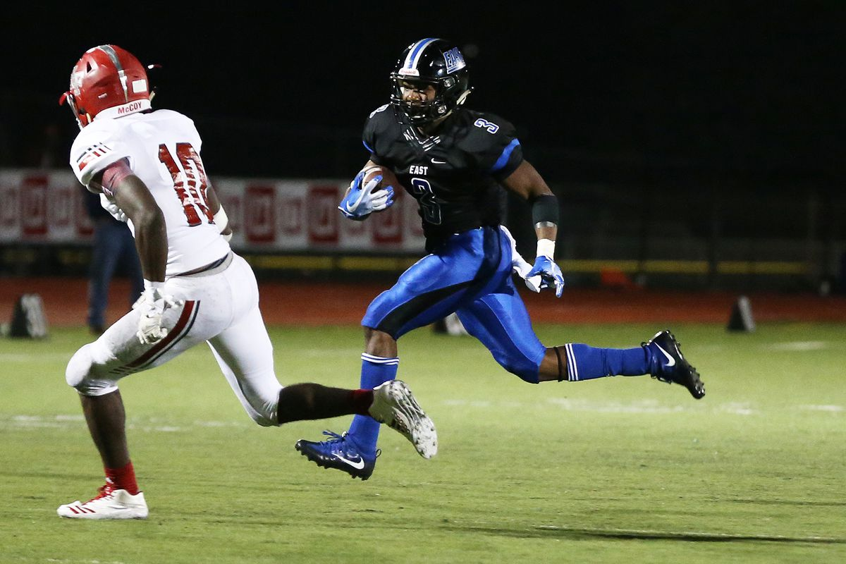 Lincoln-Way East's A.J. Henning (3) picks up yardage after the reception against Homewood-Flossmoor.