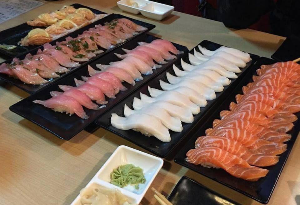 Platters containing sashimi and nigiri