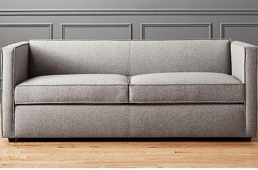 Squared gray sofa.