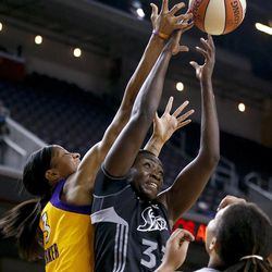 San Antonio Silver Stars' Sophia Young, center, and Los Angeles Sparks' Candace Parker reach for a rebound during Game 1 of a WNBA basketball first-round playoff series, in Los Angeles on Thursday, Sept. 27, 2012.