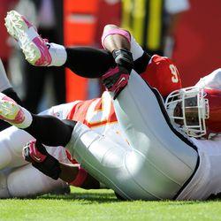 Oakland Raiders quarterback Terrelle Pryor (2) is sacked by Kansas City Chiefs inside linebacker Derrick Johnson (56) during the first half at Arrowhead Stadium.