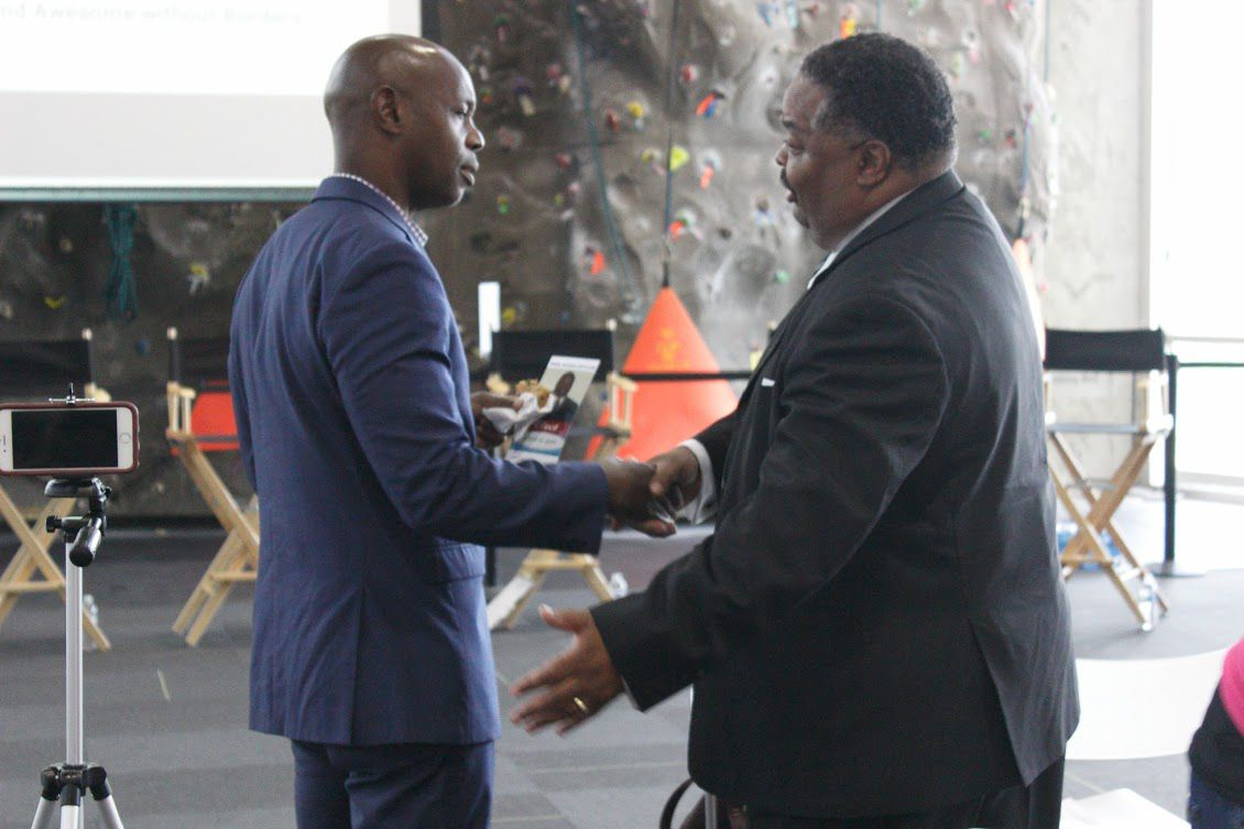 Superintendent Dorsey Hopson (left) speaks with a fellow attendee at the forum.