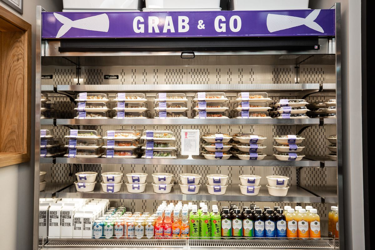 The grab and go cooler filled with prepared foods and drinks