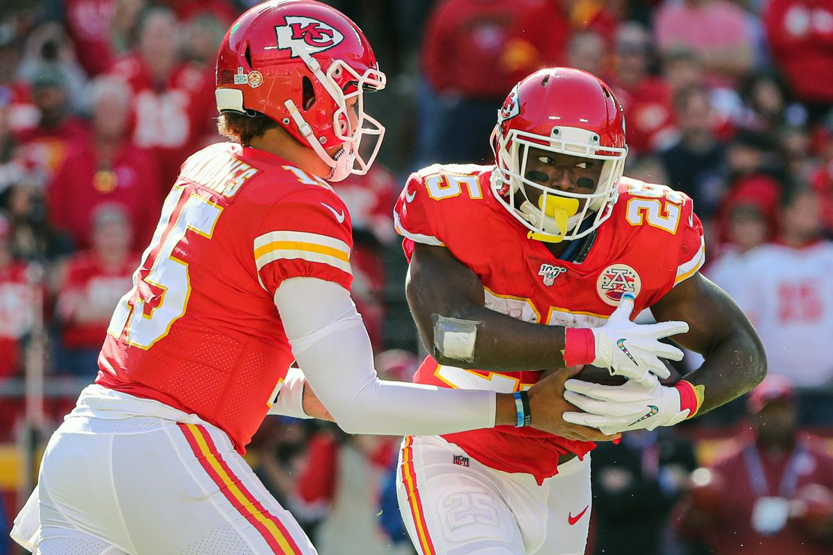 Kansas City Chiefs running back LeSean McCoy takes the handoff from quarterback Patrick Mahomes against the Houston Texans during the second half at Arrowhead Stadium.