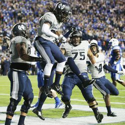 Utah State Aggies wide receiver Devonte Robinson (3) celebrates his touchdown with teammate against Brigham Young Cougars in Provo Friday, Oct. 3, 2014.
