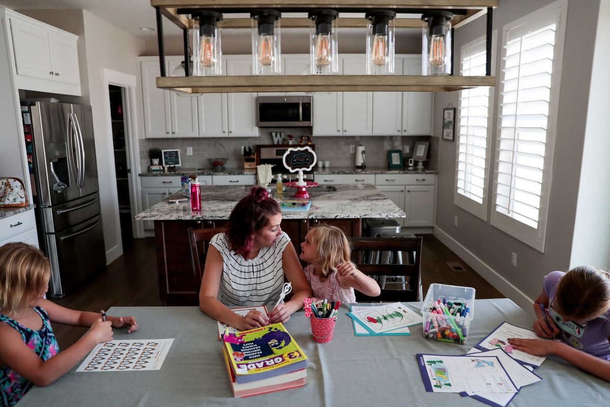 Amy Watts does educational worksheets with her daughters, Nora, 6, Eve, 4, and Reese, 9, to prepare for the coming school year at their home in Lehi on Saturday, Aug. 17, 2019.