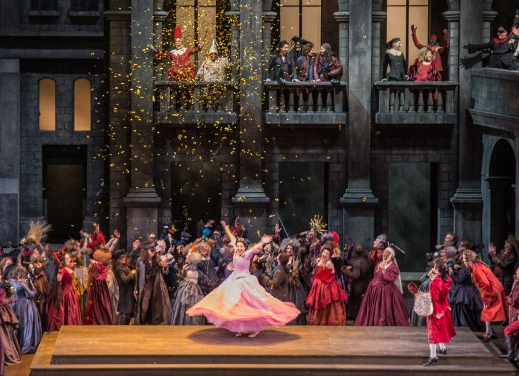 """Susanna Phillips (center, in shocking pink gown) in a scene from the Lyric Opera production of Gounod's """"Romeo and Juliet."""" (Photo: Andrew Cioffi)"""