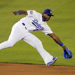 Los Angeles Dodgers shortstop Hanley Ramirez cannot reach a ball hit for a single by St. Louis Cardinals' Yadier Molina during the second inning of their baseball game, Thursday, Sept. 13, 2012, in Los Angeles.