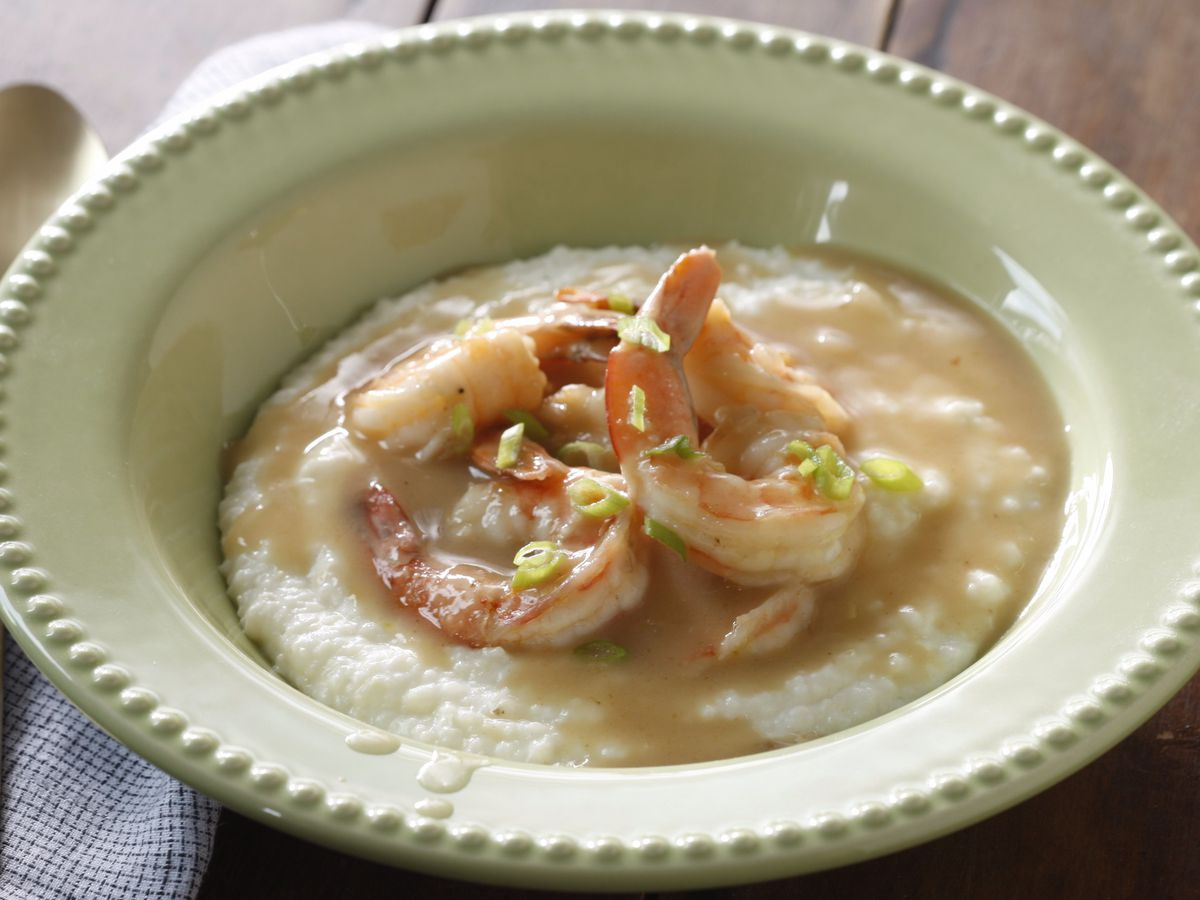 Shrimp and grits in a green bowl