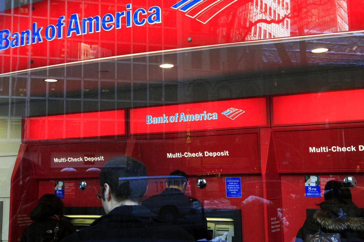 In this Jan. 31, 2011 photo, Bank of America customers use ATM machines in New York. Truly free checking accounts are becoming rarer as banks add more fees to boost their profits. Financial data publisher Bankrate.com says a survey shows only 39 percent o