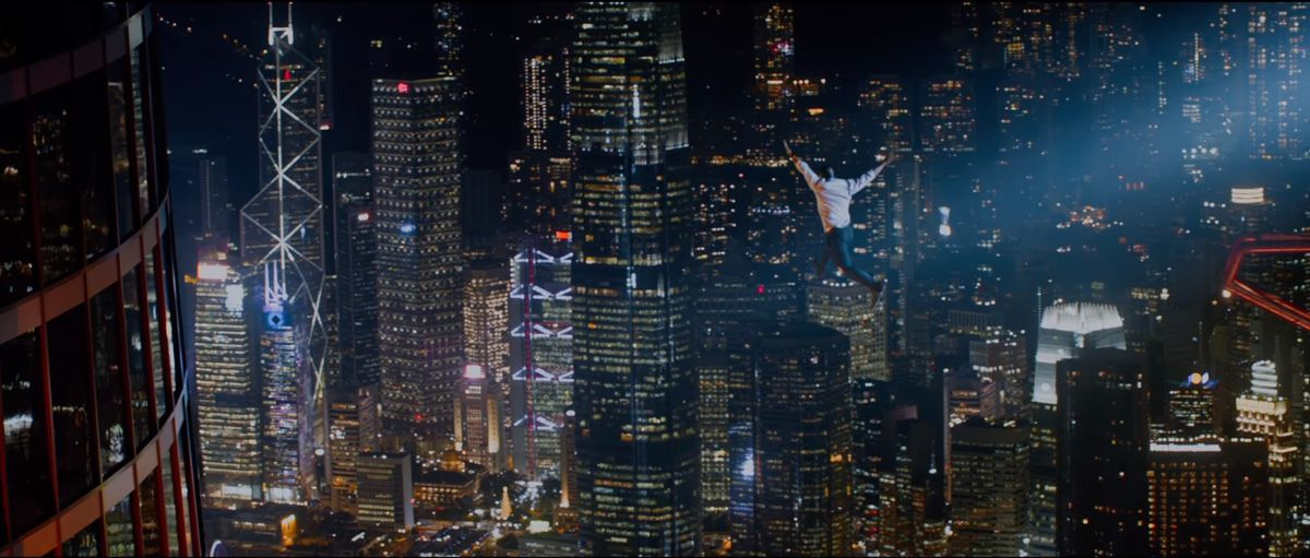 Will Sawyer (Dwayne Johnson) jumps from a crane to a skyscraper in Skyscraper